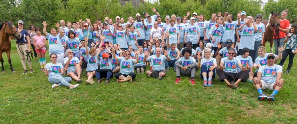 """For the past 5 years, Patron Council Chair, Duncan Jackman, has hosted Duncan's Farm day for many people in service. It's a day full of fun, BBQ's , painting, swimming, and more! Here is the gang posing for a group photo. -""""Let's see those jazz hands!"""""""